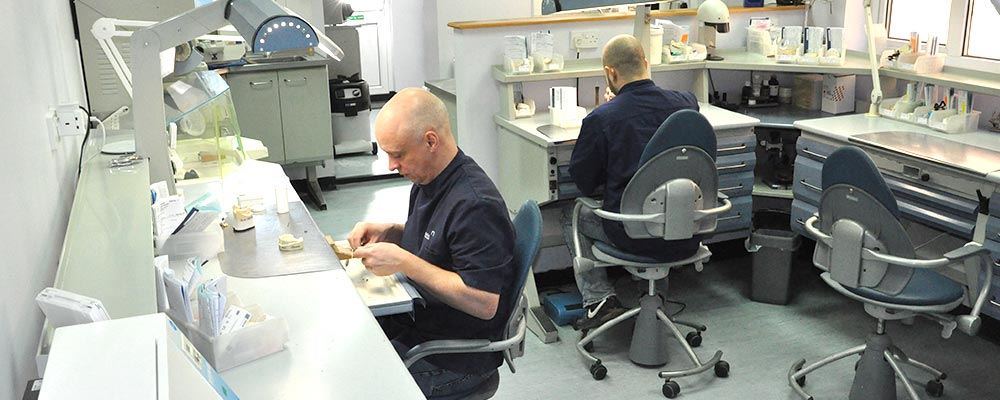 Wade Dental Laboratory technicians working at benches