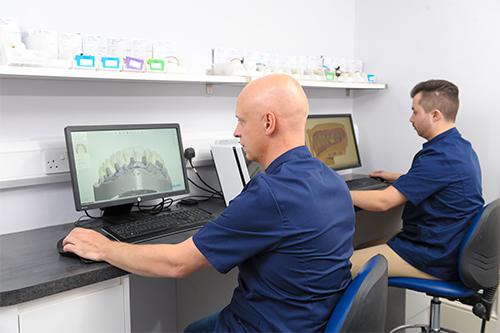 technicans at work at computers at Wade Dental Laboratory